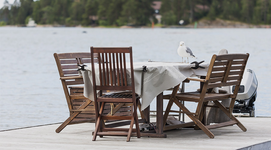 A set of garden furniture with a bird on it